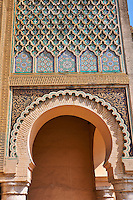 Zellij mosaics and arabesque Moorish plasterwork of the Bab Mansour gate. Named after the architect, El-Mansour, completed in 1732 the design of the gate plays with Almohad patterns. Meknes Morocco