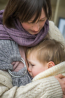 A mother breastfeeds her 15 month old boy who is in a sling.<br /> London, England, UK<br /> 22-03-2015<br /> <br /> © Paul Carter / wdiip.co.uk