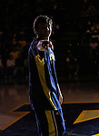 "Michigan guard Zack Novak points at the camera as he is introduced to the crowd during the college basketball team's ""Michigan Madness"" festivities at Crisler Arena, Friday, Oct. 16, 2009, in Ann Arbor, Mich. (AP Photo/Tony Ding)"