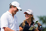 HAIKOU, CHINA - OCTOBER 30:  Hugh Grant (L) of Great Britain and Spanish golfer Belen Mozo laugh on the 11th tee during day four of the Mission Hills Start Trophy tournament at Mission Hills Resort on October 30, 2010 in Haikou, China. The Mission Hills Star Trophy is Asia's leading leisure liflestyle event and features Hollywood celebrities and international golf stars. Photo by Victor Fraile / The Power of Sport Images