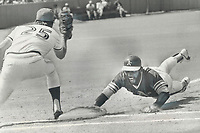 1977 FILE PHOTO - ARCHIVES -<br /> <br /> He bit the dust: Blue Jay pitcher Jim Clancy took something out of Oakland's Bill North in third inning of yesterday's game at CNE Stadium. North, a good base stealer, walked and was an obvious steal threat. Clancy's repeated tosses to first baseman Doug Ault had North shortening his lead-off just a bit, but that was enough. After several dives into the dirt, North left for second-about two steps slower than usual. Catcher Rick Cerone threw him out.<br /> <br /> <br /> Bezant, Graham<br /> Picture, 1977, <br /> <br /> 1977<br /> <br /> PHOTO : Graham Bezant - Toronto Star Archives - AQP