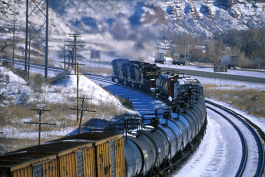 Mixed freight train in snow-covered mountains