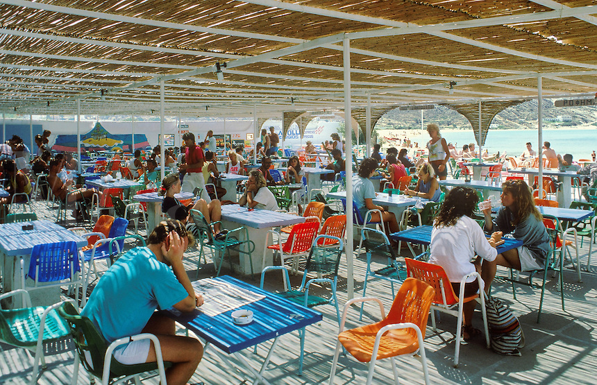 Tourists crowd the outdoor tables near the ferry port at Ios.