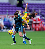 ORLANDO, FL - FEBRUARY 18: Aldana Cometti #6 of Argentina fights for the ball with Debinha #9 of Brazil during a game between Argentina and Brazil at Exploria Stadium on February 18, 2021 in Orlando, Florida.