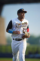 Quad Cities River Bandits first baseman Dexture McCall (27) jogs to the dugout during a game against the Bowling Green Hot Rods on July 24, 2016 at Modern Woodmen Park in Davenport, Iowa.  Quad Cities defeated Bowling Green 6-5.  (Mike Janes/Four Seam Images)