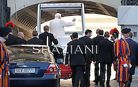 Pope Benedict XVI waves as he arrives to lead an audience with youths from the Italian catholic movement Azione Cattolica in St. Peter's Square at the Vatican oc October 30, 2010.
