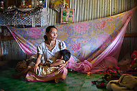 This Burmese woman hired someone to bring her and her children over the Thai/Burmese border but he took her money and deserted her. She is now raising eight children in the Burmese camp with no opportunnity for them to have healthcare or education. She realizes that she has no way that she will ever make it back to her native country.