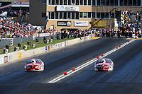Jul, 22, 2011; Morrison, CO, USA: NHRA pro stock driver Jason Line (left) alongside Greg Anderson during qualifying for the Mile High Nationals at Bandimere Speedway. Mandatory Credit: Mark J. Rebilas-