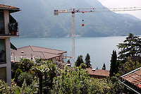 Switzerland. Canton Ticino. Lugano. Castagnola area. Construction of a private house on a deluxe standing. View on the lake of Lugano ( also called Lago Ceresio). The crane belongs to the Garzoni company. 2.06.12 © 2012 Didier Ruef