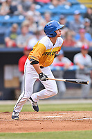 Beer City Tourists left fielder Eric Toole (14) runs to first base during a game against the Lakewood BlueClaws at McCormick Field on June 1, 2017 in Asheville, North Carolina. The Tourists defeated the BlueClaws 8-5. (Tony Farlow/Four Seam Images)