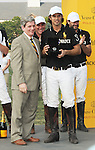 Larry Boland and Nacho Figueras (Caption of the Black Watch team) pose for pictures during the Award Ceremony at the 3rd Annual Veuve Clicquot Polo Classic on Governors Island on June 27, 2010.