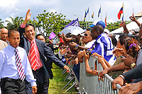 """Paul Slamet Somohardjo, former cahirman of De Nationale Assemblée (DNA) / The National Assemble of Suriname salutes NDP and """"De Mega Combinatie"""" - """"The Mega Combination"""" supporters after Desi Bouterse (Desiré Delano Bouterse) won the election of presidential election. ....Paul Slamet Somohardjo, Chairman of the Pertjajah Luhur and his party supported Desi Bouterse (Desiré Delano Bouterse)'s presidential candidate for three seat of ministries.....Desi Bouterse (Desiré Delano Bouterse) chosen as new president of Suriname by De Nationale Assemblée (DNA) / The National Assemble of Suriname. He took 36 votes of 51 as leader of the Mega Combination. ....Robert_Ameerali the head of KKF (Kamer van Koophandel en Fabrieken) / Chamber of Commerce and Industry also selected as Vice President.....Desi Bouterse (Desiré Delano Bouterse) will sworn at 3 August 2010"""