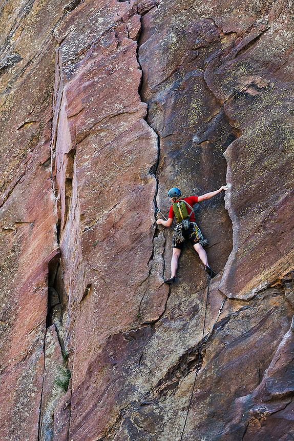 Man rock climbing, Eldorado Canyon State Park, Colorado, USA