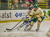 4 January 2014:  University of Vermont Catamount Forward H.T. Lenz, a Senior from Vienna, VA, gets the puck away from Yale University Bulldog defenseman Tommy Fallen, a Junior from Plymouth, MN, in the second period at Gutterson Fieldhouse in Burlington, Vermont. With an empty net and seconds remaining, the Cats came back to tie the game 3-3 against the 10th seeded Bulldogs. Mandatory Credit: Ed Wolfstein Photo *** RAW (NEF) Image File Available ***
