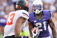 TCU tailback Kyle Hicks (21) looks at Oklahoma State safety Jordan Sterns (13) after making a catch during second half of an NCAA football game, Saturday, October 18, 2014 in Fort Worth, Tex. TCU defeated Oklahoma State 42-9. (Mo Khursheed/TFV Media via AP Images)