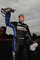 Sept. 18, 2011; Concord, NC, USA: NHRA funny car driver Matt Hagan celebrates after winning the O'Reilly Auto Parts Nationals at zMax Dragway. Mandatory Credit: Mark J. Rebilas-