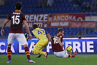 Calcio, Serie A: Roma vs ChievoVerona. Roma, stadio Olimpico, 31 ottobre 2013.<br /> AS Roma midfielder Daniele De Rossi, right, and ChievoVerona forward Alberto Paloschi fight for the ball past AS Roma midfielder Miralem Pjanic, during the Italian Serie A football match between AS Roma and ChievoVerona at Rome's Olympic stadium, 31 October 2013.<br /> UPDATE IMAGES PRESS/Isabella Bonotto