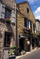 France, Vezelay, Burgundy, Yonne, wine region, Bourgogne, Europe, Shops along a narrow street in Vezelay in the wine region of Burgundy.