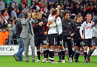 ATTENTION SPORTS PICTURE DESK<br /> Pictured: A delighted Paulo Sousa manager for Swansea (L) celebrating with his players after the final whistle<br /> Re: Coca Cola Championship, Swansea City Football Club v Cardiff City FC at the Liberty Stadium, Swansea, south Wales. Saturday 07 November 2009
