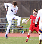 WINSTED CT. - 17 November 2020-111720SV01-#34 Harry Schopp of Housatonic clears a ball from #22 Trevor Mogielnick of Northwestern during Berkshire League boy's soccer tournament action in Winsted Tuesday.<br /> Steven Valenti Republican-American