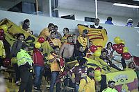 BOGOTA- COLOMBIA – 04-02-2014: Hinchas del Monarcas Morelia de Mexico, animan a su equipo durante partido entre Independiente Santa Fe y Monarcas Morelia de la primera fase llave G5, de la Copa Bridgestone Libertadores en el estadio Nemesio Camacho El Campin, de la ciudad de Bogota. / Fans of Monarcas Morelia of Mexico, cheer for their team  during a match between Independiente Santa Fe and Monarcas Morelia or the first phase, G5 key, of the Copa Bridgestone Libertadores in the Nemesio Camacho El Campin in Bogota city. Photo: VizzorImage / Luis Ramirez / Staff.