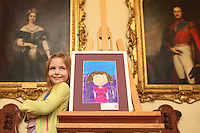 "06/04/2009.Jenna Reeves (5) from Limerick with her painting entitled ""New Dress"" which came 3rd in category F (4-6 year olds) during the Texaco Childrens Art Competition at Dublin Castle, Dublin..Photo: Gareth Chaney Collins"