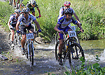 Andy MacDonald (268) and Henry Jaine (219)  cross the first ford. Mammoth Adventure MTB Ride, Nelson<br /> Photo: Marc Palmano/shuttersport.co.nz