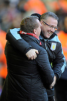 15.12.2012. Liverpool, England.    Brendan Rogers Manager of Liverpool and Paul Lambert Manager of Aston Villa during the Premier League game between Liverpool and Aston Villa from Anfield,Liverpool