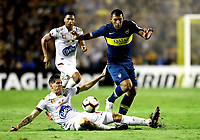 "BUENOS AIRES-ARGENTINA, 12-03- 2019: Ramón Abila de Boca Juniors (ARG) disputa el balón con Juan Vargas de Deportes Tolima (COL), durante partido de la fase de grupos, grupo G, fecha 2, entre Boca Juniors (ARG) y Deportes Tolima (COL), por la Copa Conmebol Libertadores 2019, en el estadio Alberto J. Armando ""La Bombonera"", de la ciudad Ciudad Autónoma de Buenos Aires. / Ramón Abila of Boca Juniors (ARG) vies for the ball with Juan Vargas of Deportes Tolima (COL), during a match of the groups phase, group G, 2nd date, beween Boca Juniors (ARG) and  Deportes Tolima (COL), for the Conmebol Libertadores Cup 2018, at the Alberto J. Armando ""La Bombonera"" Stadium, in Ciudad Autonoma de Buenos Aires. VizzorImage / Javier García Martino / Photogamma / Cont."
