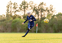 ORLANDO, FL - JANUARY 21: Megan Rapinoe #15 of the USWNT takes a free kick during a training session at the practice fields on January 21, 2021 in Orlando, Florida.