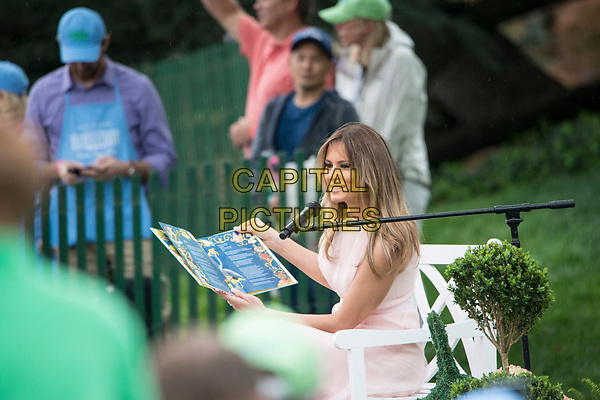 Washington DC, April 17, 2017, USA: First Lady Melania Trump reads a book to  visitors to the South Lawn of the White House for the 139th Annual Easter Egg roll and event in Washington DC. <br /> CAP/MPI/LYN<br /> ©LYN/MPI/Capital Pictures