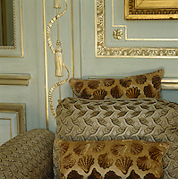 Inspired by the Amalienburg Palace in Munich the  panelling in the salon is painted a pale eau de nil with elaborate gilded mouldings