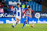Angel Correa (r) of Atletico de Madrid battles for the ball with Alberto Bueno Calvo of Deportivo Leganes during their La Liga match between Atletico de Madrid and Deportivo Leganes at the Vicente Calderón Stadium on 04 February 2017 in Madrid, Spain. Photo by Diego Gonzalez Souto / Power Sport Images