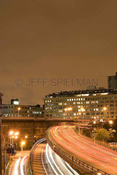 AVAILABLE FROM JEFF AS A FINE ART PRINT.<br /> <br /> AVAILABLE FOR COMMERCIAL AND EDITORIAL LICENSING FROM PLAINPICTURE.  Please go to www.plainpicture.com and search for image # p5690021.<br /> <br /> Highway on an Overcast Night, Brooklyn-Queens Expressway, Brooklyn, New York City, New York State, USA