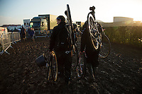 29 NOV 2014 - MILTON KEYNES, GBR - Pit crews walk back to their team caravans with their riders spare bikes after the men's 2014-2015 UCI Cyclo-Cross World Cup round in Campbell Park in Milton Keynes, Great Britain (PHOTO COPYRIGHT © 2014 NIGEL FARROW, ALL RIGHTS RESERVED)
