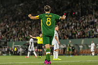 Portland, Oregon - Wednesday September 25, 2019: Diego Valeri #8 celebrates as the Portland Timbers score their second goal during a regular season game between Portland Timbers and New England Revolution at Providence Park on September 25, 2019 in Portland, Oregon.