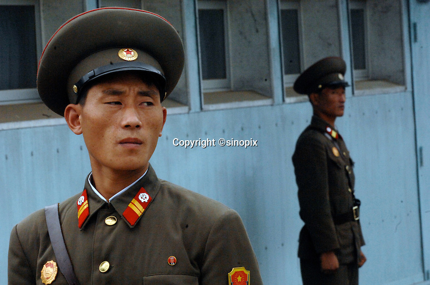 North Korean soldiers guard the demilitarized zone (DMZ) at Panmunjom, North Korea.
