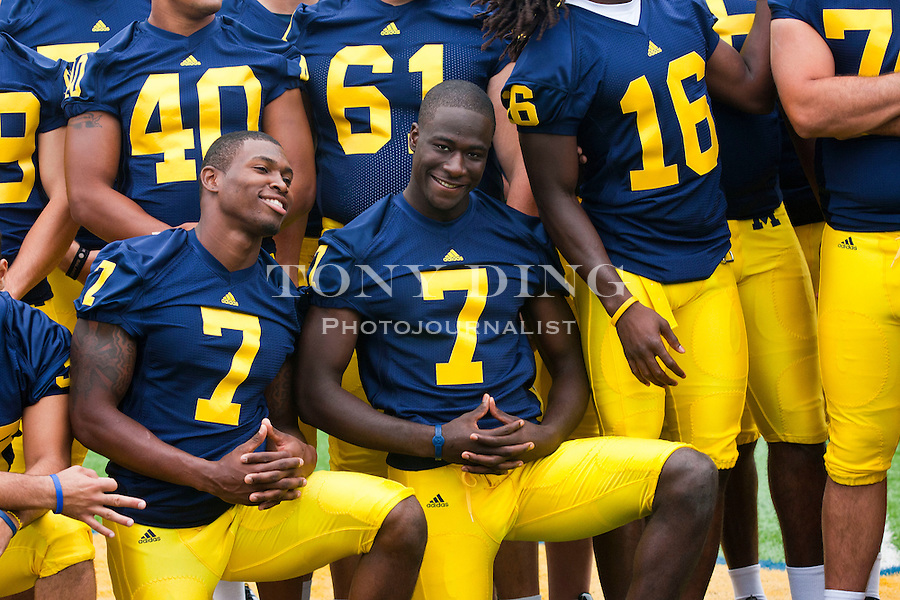 Michigan linebacker Brandin Hawthorne, left, and quarterback Devin Gardner, center, jokingly pose for photographers, at the annual NCAA college football media day, Sunday, Aug. 22, 2010, in Ann Arbor, Mich. (AP Photo/Tony Ding)
