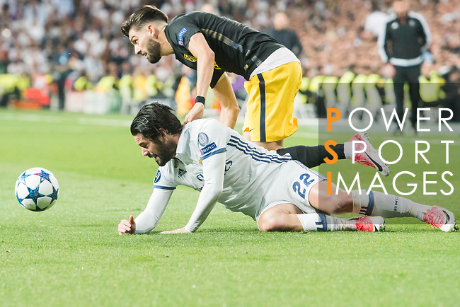 Isco Alarcon of Real Madrid falls as he battles for the ball with Yannick Ferreira Carrasco of Atletico de Madrid during their 2016-17 UEFA Champions League Semifinals 1st leg match between Real Madrid and Atletico de Madrid at the Estadio Santiago Bernabeu on 02 May 2017 in Madrid, Spain. Photo by Diego Gonzalez Souto / Power Sport Images