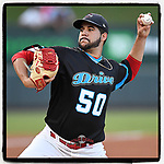 Starting pitcher Enmanuel De Jesus (50) of the Greenville Drive wears a Carolina Panthers-inspired jersey in a game against the Greensboro Grasshoppers on Thursday, August 16, 2018, at Fluor Field at the West End in Greenville, South Carolina. Greenville won, 4-2. (Tom Priddy/Four Seam Images)