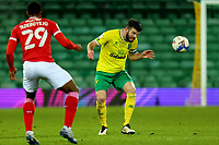 2nd January 2021; Carrow Road, Norwich, Norfolk, England, English Football League Championship Football, Norwich versus Barnsley; Grant Hanley of Norwich City careful as he heads the ball after suffering a head injury