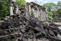 """Cambodia, Beng Mealea Fallen Stones in front of """"Library"""", south side, 12th. Century."""