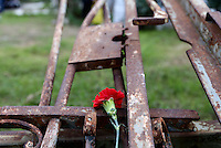 Pictured: A carnation is left at the remnants of the crashed gates part of the the uprising monument at the Athens Polytechinc in Athens Greece. Wednesday 16 November 2016<br /> Re: 43rd anniversary of the Athens Polytechnic uprising of 1973 which was a massive demonstration of popular rejection of the Greek military junta of 1967–1974. The uprising began on November 14, 1973, escalated to an open anti-junta revolt and ended in bloodshed in the early morning of November 17 after a series of events starting with a tank crashing through the gates of the Polytechnic.