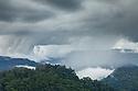 The rim of Maliau Basin (visible at back of image) towers above the area of dense rainforest that it encloses. Maliau Basin, Sabah's 'Lost World', Borneo, Malaysia.