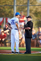 South Dakota State Jackrabbits head coach Rob Bishop (26) questions a call with umpire Mark Spicer during a game against the Northeastern Huskies on February 23, 2019 at North Charlotte Regional Park in Port Charlotte, Florida.  Northeastern defeated South Dakota State 12-9.  (Mike Janes/Four Seam Images)