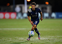 LAKE BUENA VISTA, FL - JULY 26: Graham Zusi of Sporting KC runs with the ball during a game between Vancouver Whitecaps and Sporting Kansas City at ESPN Wide World of Sports on July 26, 2020 in Lake Buena Vista, Florida.