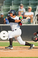 Miguel Gonzalez #12 of the Kannapolis Intimidators follows through on his swing against the Hagerstown Suns at Fieldcrest Cannon Stadium August 8, 2010, in Kannapolis, North Carolina.  Photo by Brian Westerholt / Four Seam Images