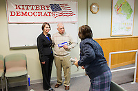 Sarah Woodard, Shenna Bellows' state finance director, takes a picture of Bellows with Frank DeSarro, elected Secretary of the Kittery Democrats during the town caucus, after Bellows spoke at the Kittery Democrats town caucus in the Town Hall Council Chambers in Kittery, Maine, USA, on March 3, 2014. Bellows is trying to unseat incumbent Maine Republican Senator Susan Collins in the 2014 election. The town caucus had speeches from various other local candidates and also served to choose delegates for the 2014 Maine State Democratic Caucus.