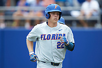 JJ Schwarz (22) of the Florida Gators returns to his dugout after hitting a home run against the Wake Forest Demon Deacons in the completion of Game Two of the Gainesville Super Regional of the 2017 College World Series at Alfred McKethan Stadium at Perry Field on June 12, 2017 in Gainesville, Florida. The Demon Deacons walked off the Gators 8-6 in 11 innings. (Brian Westerholt/Four Seam Images)