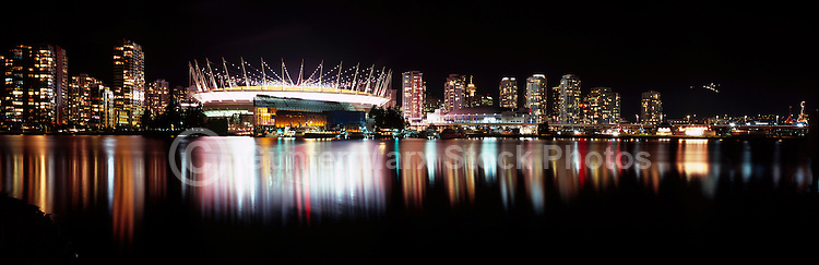 BC Place Stadium (New Retractable Roof completed in 2011) dominates Downtown Vancouver City Skyline at False Creek, Vancouver, BC, British Columbia, Canada, at Night - Panoramic View